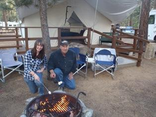 Two people at Camp 6  fire pit