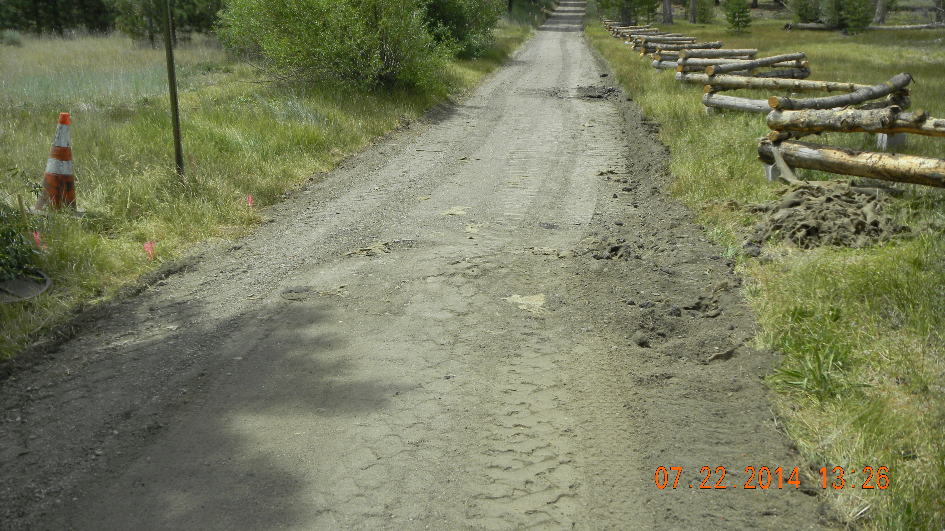 Dirt road with cone