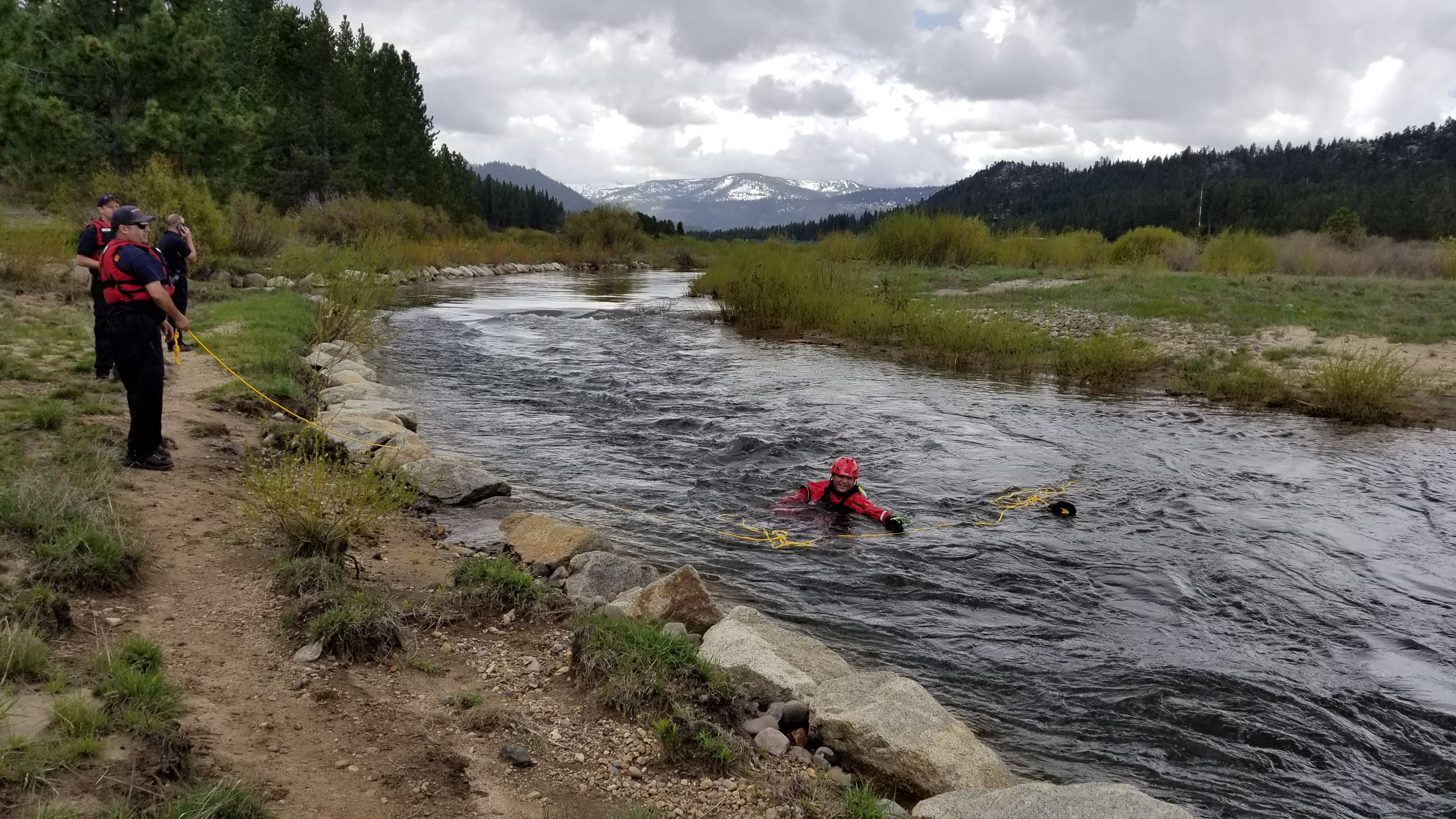 photo of firefighters in the water training for swift water rescue